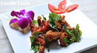 Fried chicken with hot basil leaves ไก่ผัดใบกระเพรา